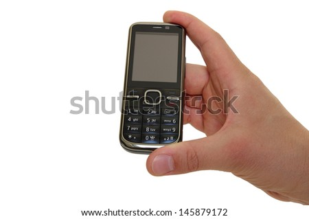 a hand holding a feature phone - stock photo