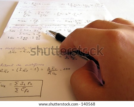 A hand holding a pen with page in background - stock photo