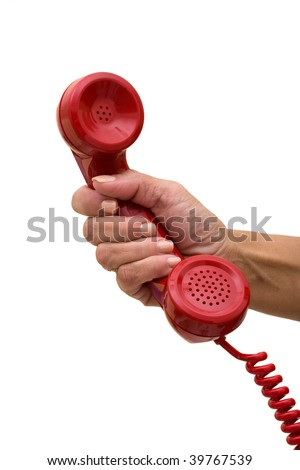 A hand holding a red handset of a telephone isolated on a white background, answering the telephone - stock photo