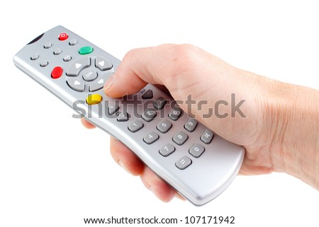 A hand holding a remote control, isolated on white background - stock photo