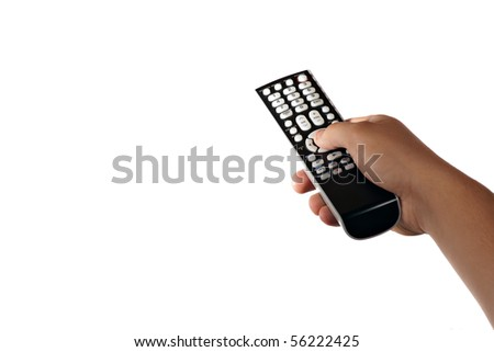A hand holding a remote control isolated over a white background. - stock photo