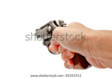 A hand holding a revolver gun ready to shoot - stock photo