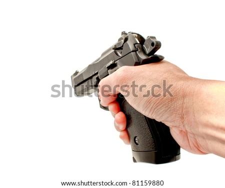 A hand holding a semi automatic handgun that is in ready position to shoot, studio shot - stock photo