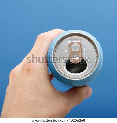 A hand holding a soft drink