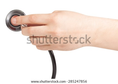 A hand holding a stethoscope isolated on white background - stock photo