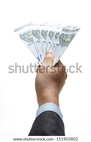 A hand holding an money  - stock photo