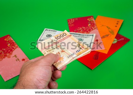 a hand holding money, Singapore dollars note in a red envelope (red pack money red pack money red pack money red pack money red pack money red pack money red pack money red pack money red pack money