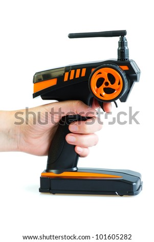 A hand holding radio controlled (RC) transmitter for model cars - stock photo
