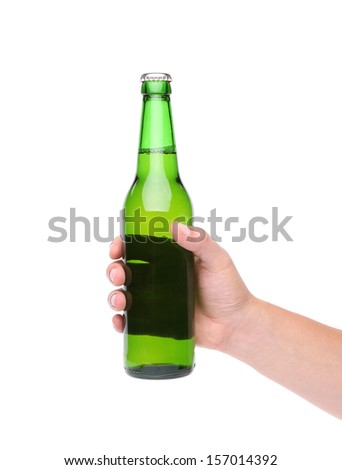 A hand holding up a green beer bottle without label over a white background vertical format - stock photo