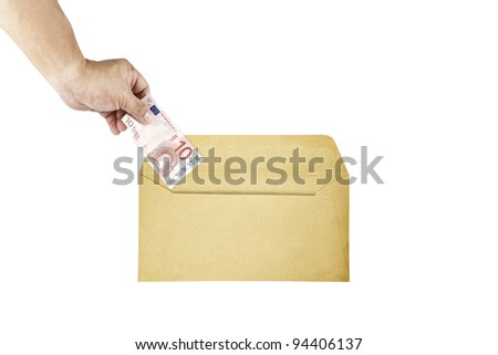 A hand inserting a ten euro currency bill into a brown paper envelope, isolated against white. - stock photo