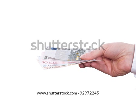 A hand is holding some euro notes