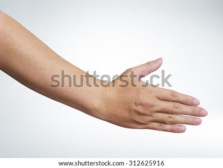 A hand is reaching out so it can shake hands.with clipping path - stock photo