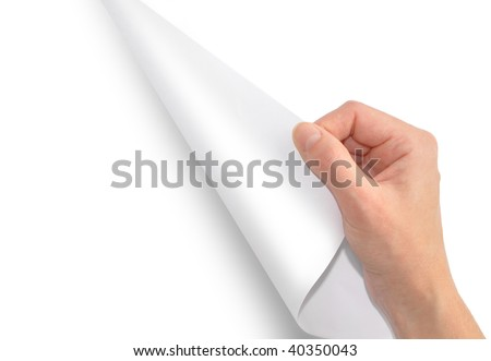 A hand is turning or flipping a blank page over. The page is white and you can insert your text in the blank area. - stock photo