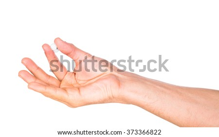 A hand of a man hold two pills isolated on white background