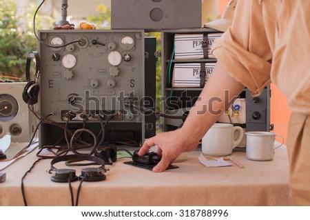 A hand of a man using a World War telegraph. - stock photo