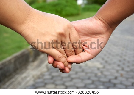 A hand of mother and daughter hold with love