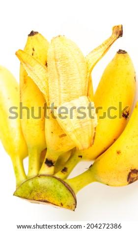 a hand of ripe yellow sweet bananas - stock photo