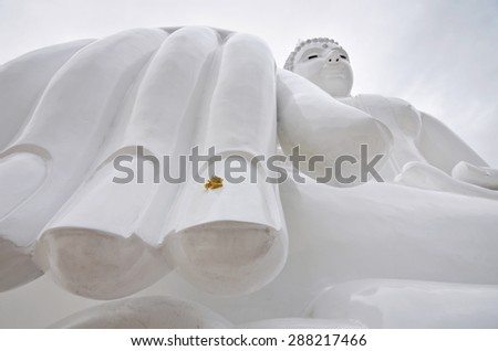 a hand of White buddha status on  sky background - stock photo