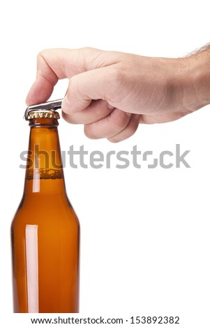 A hand opening a bottle of beer.