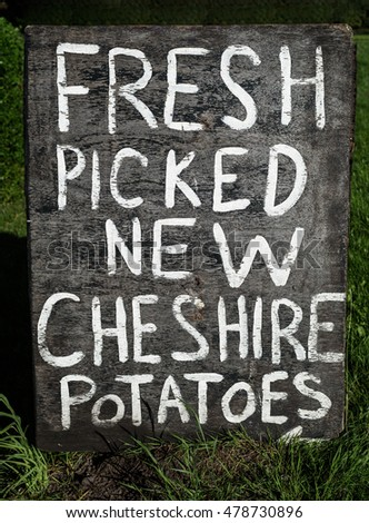 A hand painted rustic farm potato sign.