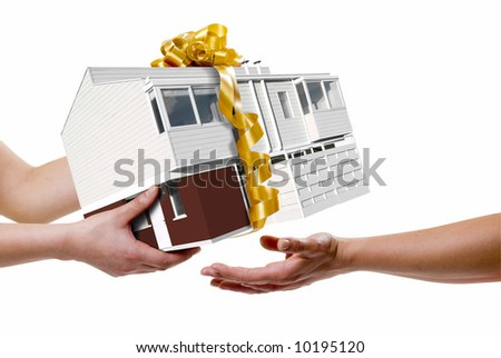 a hand picking a house, all isolated over white - stock photo
