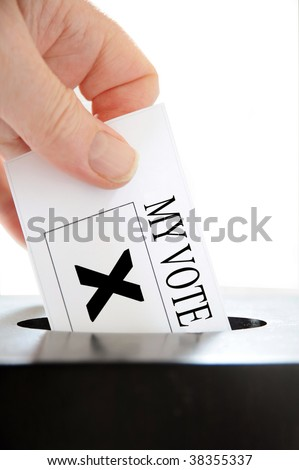 A hand placing a voting slip into a ballot box over a white background