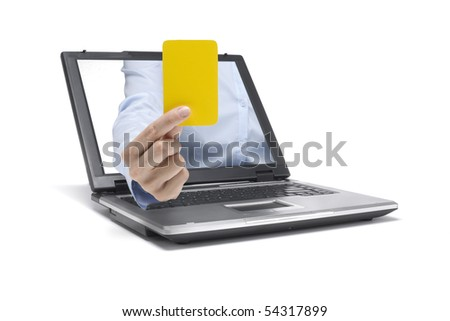 a hand reaches out of a laptop and shows a yellow card - stock photo