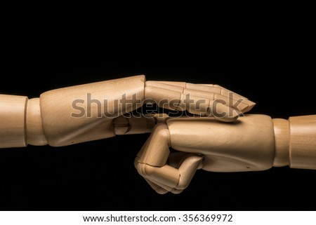 A hand soothes a closed fist. Black background - stock photo