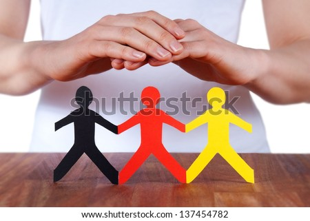 a hand symbolizes the protection of people, isolated - stock photo