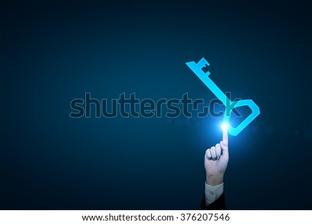 A hand touching a blue key which gets activated. Blue background. Concept of finding a solution. - stock photo