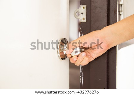 A hand trying to open the door by holding the doorknob with a white copy space & Man Hand Open Door Knob Stock Photo 133893713 - Shutterstock Pezcame.Com
