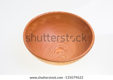 A hand turned wooden bowl isolated on white