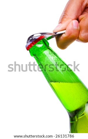 A hand using bottle opener is about to open the beer