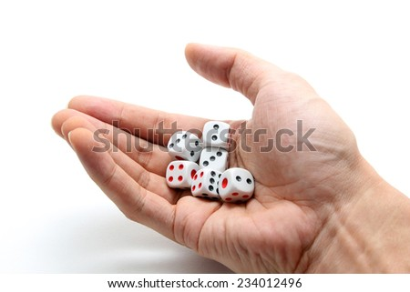 A hand with a bunch of dice - stock photo