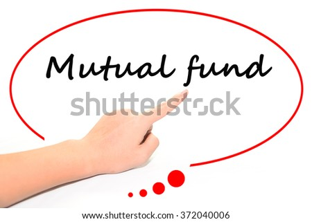 A hand with a marker writing 'mutual fund'.  Isolated on office. Business, technology, stock market concept. - stock photo