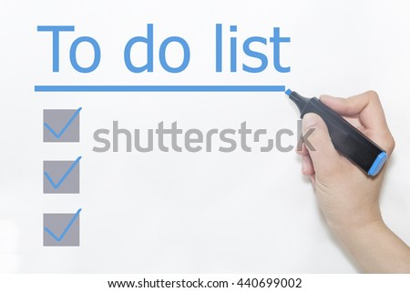 A hand with a marker writing 'To Do List' - stock photo