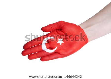 a hand with turkish flag in handshake gesture