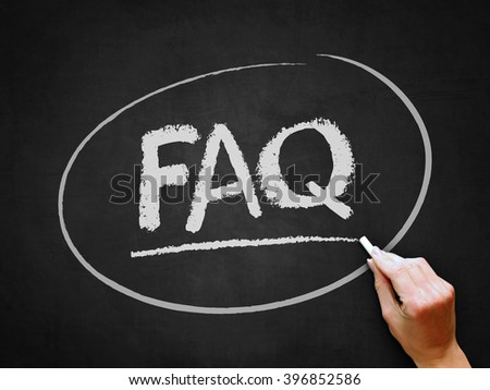 A hand writing 'FAQ' on chalkboard. - stock photo