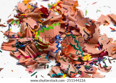 a handful of chips of colored pencils on white background - stock photo