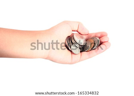 A handful of coins in the palm of a hand - stock photo