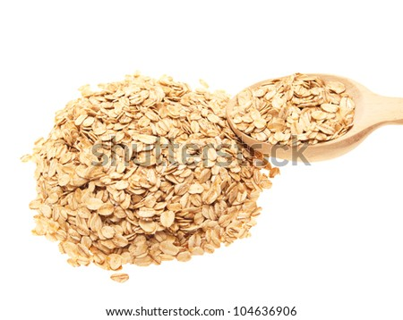 A handful of oatmeal with a wooden spoon. On a white background.