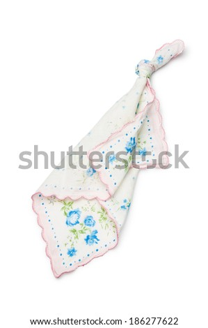 A handkerchief with a knot, to remember something to not forget, isolated on white background - stock photo