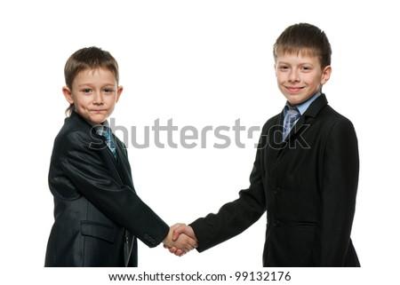 A handshake of two schoolboys; isolated on the white background - stock photo