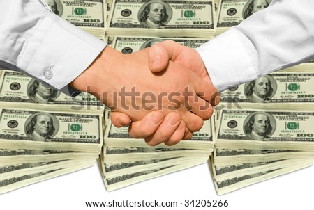 a handshake over background money - stock photo
