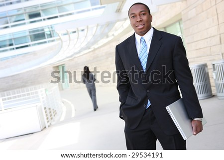 A handsome african american business man with laptop computer - stock photo