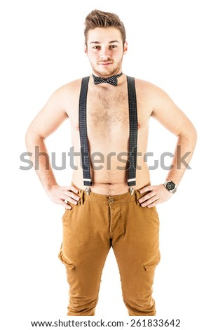 a handsome and sexy shirtless young man with braces and a bow tie isolated over a white background - stock photo