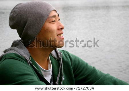 A handsome asian man smiling - stock photo