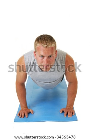 A handsome athletic man doing push ups - stock photo