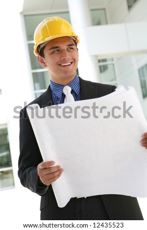 A handsome business construction man on the work site - stock photo