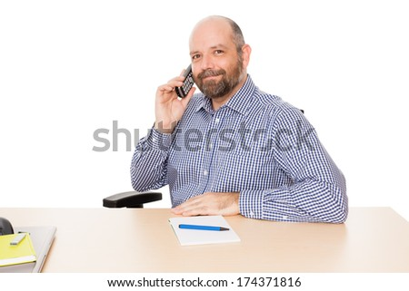 A handsome business man at the phone, isolated on white background. - stock photo